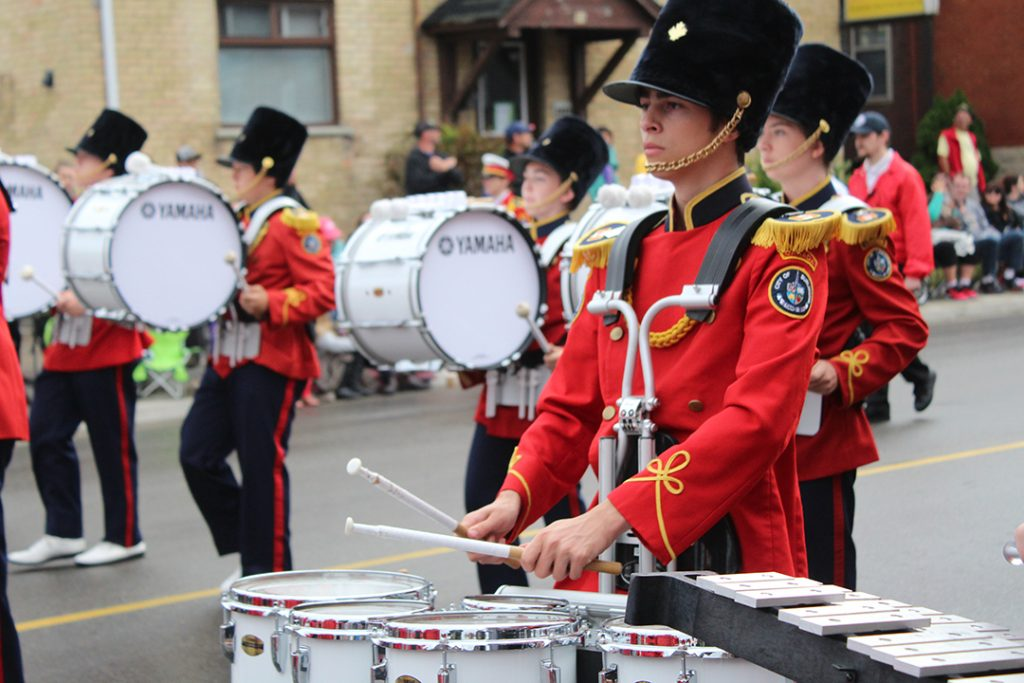 Drummers in the Burlington Teen Tour Band march in the parade. Thousands of people were in attendance and non-perishable food was collected along the route.